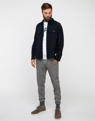 How to Wear a White and Black Print Crew-neck T-shirt For Men: A white and black print crew-neck t-shirt and grey sweatpants have become veritable closet pieces. A pair of grey suede derby shoes immediately spruces up any ensemble.