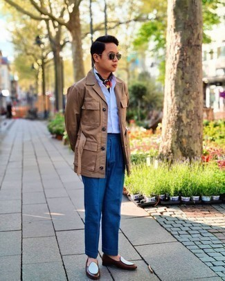 Tan Shirt Jacket Outfits For Men: A tan shirt jacket and blue dress pants are absolute must-haves if you're putting together a classic wardrobe that holds to the highest menswear standards. Brown leather loafers are a welcome complement for your ensemble.