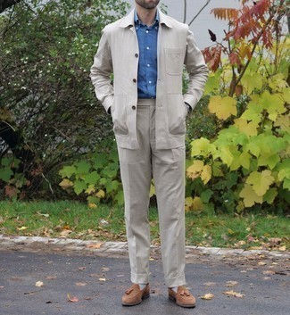 Navy Dress Shirt Outfits For Men: Teaming a navy dress shirt with beige dress pants is a smart pick for a stylish and sophisticated look. For a more laid-back spin, why not rock a pair of brown suede tassel loafers?
