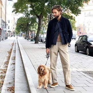 Navy Quilted Gilet Outfits For Men: Wear a navy quilted gilet with beige chinos for an everyday outfit that's full of charisma and character. Complement your ensemble with a pair of tan suede slip-on sneakers and you're all set looking amazing.