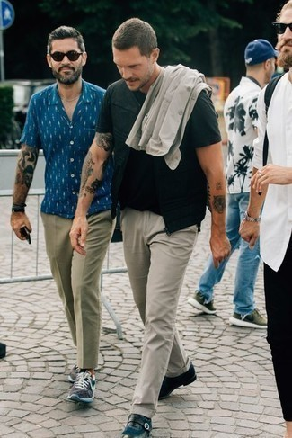 Black Gilet Outfits For Men: Putting together a black gilet and grey chinos will prove your skills in men's fashion even on dress-down days. To give this ensemble a dressier spin, why not complement your ensemble with navy leather monks?