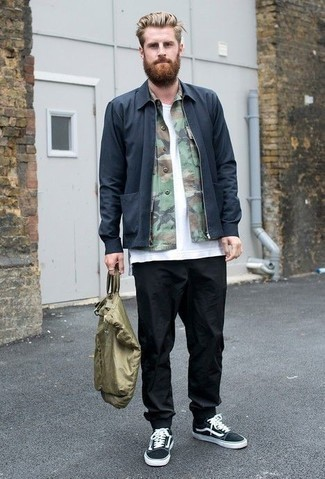 Olive Camouflage Shirt Jacket with Black Sneakers Casual Fall Outfits For Men: This off-duty pairing of an olive camouflage shirt jacket and black chinos is extremely easy to put together in seconds time, helping you look awesome and ready for anything without spending a ton of time going through your wardrobe. Add black sneakers to the mix to make an all-too-safe getup feel suddenly edgier. Keep the autumn blues at bay in a kick-ass outfit like this one.
