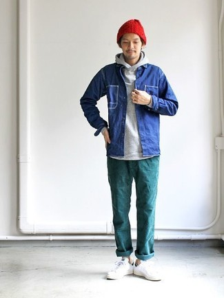 How to wear: blue denim shirt jacket, grey hoodie, teal chinos, white leather low top sneakers