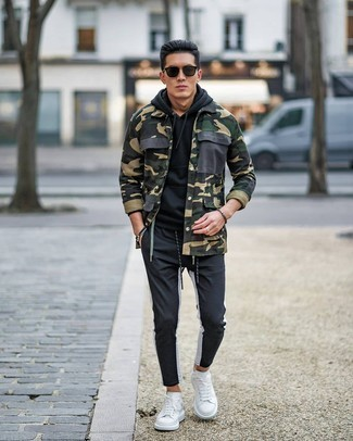 Black Beaded Bracelet Outfits For Men: An olive camouflage shirt jacket and a black beaded bracelet are both versatile menswear staples that will integrate perfectly within your current casual arsenal. White leather low top sneakers are a guaranteed way to give a hint of sophistication to your look.
