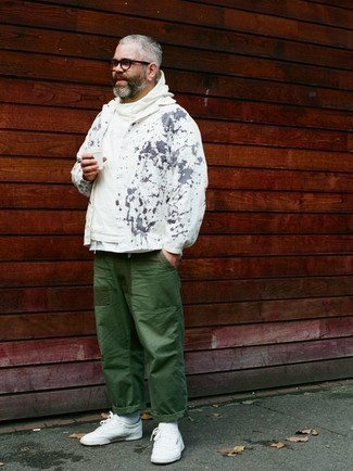 How to Wear a White Hoodie For Men: A white hoodie and dark green chinos are among the fundamental items in any gent's functional casual wardrobe. As for shoes, add white canvas low top sneakers to the mix.