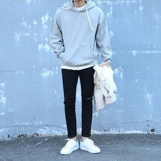 Grey Hoodie Outfits For Men: For something on the casual end, consider pairing a grey hoodie with black ripped jeans. Make this getup slightly more sophisticated by finishing with a pair of white canvas low top sneakers.