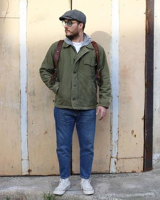 Brown Leather Backpack Outfits For Men: Make an olive shirt jacket and a brown leather backpack your outfit choice to get a bold casual and stylish look. A cool pair of white canvas high top sneakers pulls this outfit together.