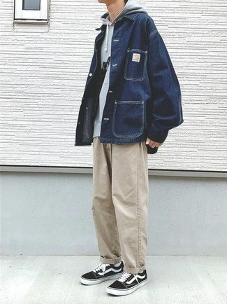 How to Wear a Navy Denim Shirt Jacket For Men: Why not pair a navy denim shirt jacket with beige jeans? Both pieces are totally practical and look nice paired together. For something more on the casually edgy end to finish off this ensemble, introduce black and white canvas low top sneakers to the mix.