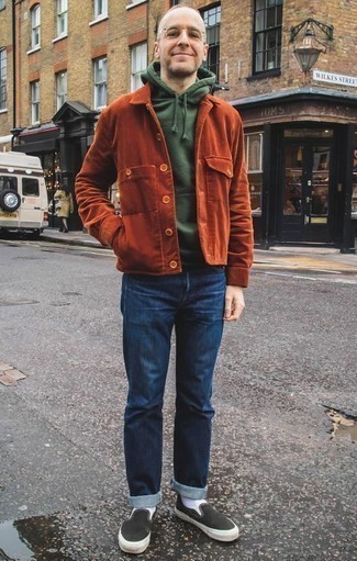 How to Wear a Dark Green Hoodie For Men: A dark green hoodie and navy jeans have become veritable closet staples for most men. On the fence about how to finish this ensemble? Finish with black and white canvas slip-on sneakers to kick it up a notch.
