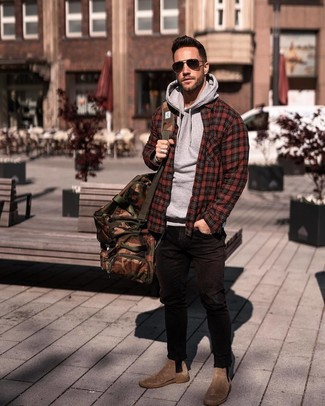 How to wear: red plaid shirt jacket, grey hoodie, black skinny jeans, brown suede chelsea boots