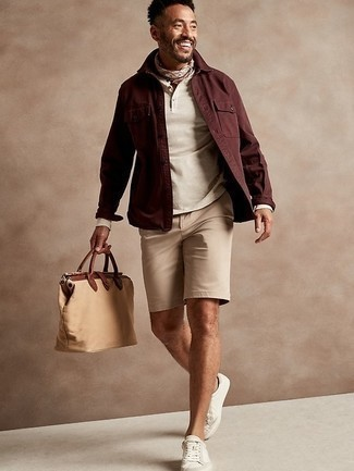 Beige Long Sleeve Henley Shirt Outfits For Men: A beige long sleeve henley shirt and tan shorts? It's an easy-to-style ensemble that any gent could wear a variation of on a daily basis. Introduce a pair of white canvas low top sneakers to the equation and the whole look will come together.