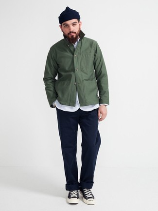How to wear: dark green shirt jacket, light blue chambray long sleeve shirt, navy chinos, black and white canvas high top sneakers