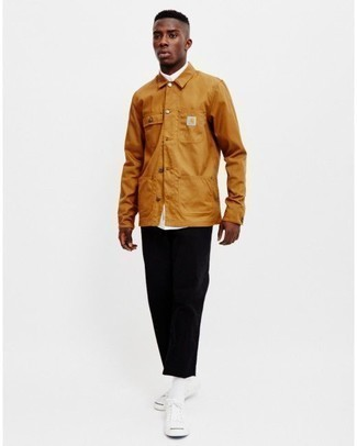 How to Wear Black Corduroy Chinos: For a casually neat ensemble, try teaming a tobacco shirt jacket with black corduroy chinos — these two pieces fit really well together. Up this whole ensemble with white canvas low top sneakers.