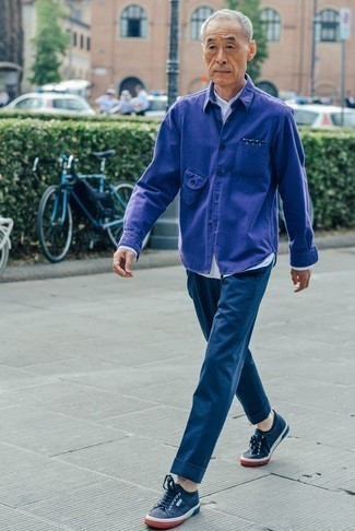 Fashion for Men Over 60: What To Wear: Marry a violet shirt jacket with navy chinos to assemble an interesting and pulled together ensemble. You could perhaps get a bit experimental in the shoe department and play down your getup with navy canvas low top sneakers. And if we're talking style for mature gentlemen, this look is a good look on almost anyone.