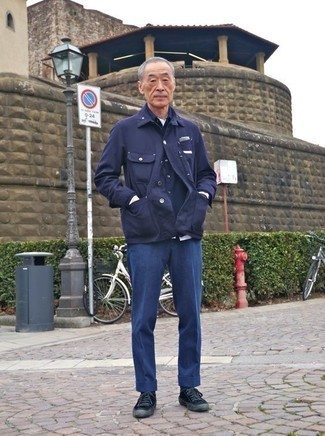 Fashion for Men Over 60: What To Wear: This combination of a navy shirt jacket and navy chinos looks well-executed and immediately makes you look cool. Introduce navy canvas low top sneakers to the mix to add a touch of stylish casualness to your getup. This combination is a clear example 60-something men can still very well draw compliments.