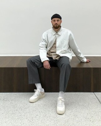 How to Wear White Leather Low Top Sneakers For Men: For a look that's street-style-worthy and effortlessly polished, wear a white shirt jacket and charcoal chinos. Rounding off with white leather low top sneakers is a surefire way to inject a mellow vibe into your outfit.