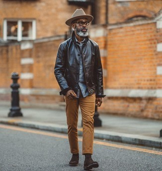 Black Leather Jacket with Shoes Outfits For Men After 50: Wear a black leather jacket with tobacco chinos for a clean classy look. Amp up the cool of your look by slipping into a pair of dark brown suede chelsea boots. This combination illustrates that even in your 50s your sartorial options are far from limited.