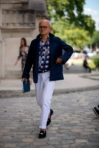 Men's Outfits 2021: For a casually classic look, opt for a navy shirt jacket and white chinos — these two items play nicely together. For something more on the classier end to complement this look, introduce navy embroidered velvet loafers to the equation.