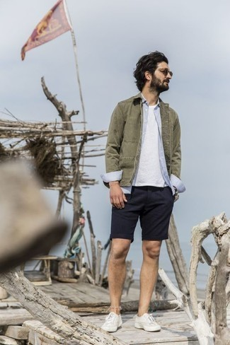 Low Top Sneakers Outfits For Men: This casual and cool look is really pared down: an olive shirt jacket and navy shorts. Feeling venturesome? Jazz things up by finishing with a pair of low top sneakers.