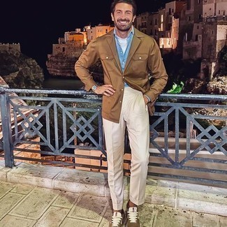 Gold Watch Outfits For Men After 40: A tan shirt jacket and a gold watch are a cool combo to add to your day-to-day wardrobe. Complement your outfit with brown athletic shoes and ta-da: the getup is complete. All in all, a good option when it comes to dressing ideas for middle-aged guys.