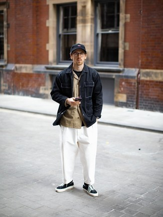 Navy Baseball Cap Outfits For Men: You'll be amazed at how easy it is for any gentleman to get dressed this way. Just a black shirt jacket paired with a navy baseball cap. Finishing with black and white canvas low top sneakers is a fail-safe way to inject an air of elegance into this outfit.