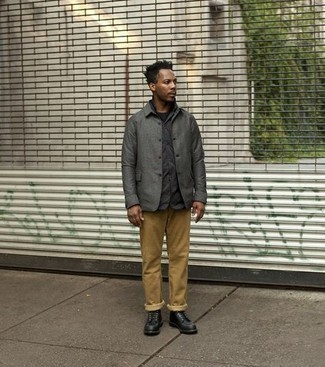Black Leather Casual Boots Outfits For Men: This combo of a charcoal shirt jacket and khaki chinos falls somewhere between dressy and casual. Complement this look with black leather casual boots and ta-da: this outfit is complete.