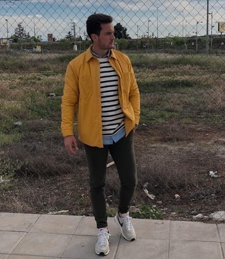Dark Green Chinos Outfits: For a look that's pared-down but can be smartened up or dressed down in a myriad of different ways, marry a mustard shirt jacket with dark green chinos. Let your outfit coordination sensibilities really shine by completing this look with a pair of beige athletic shoes.
