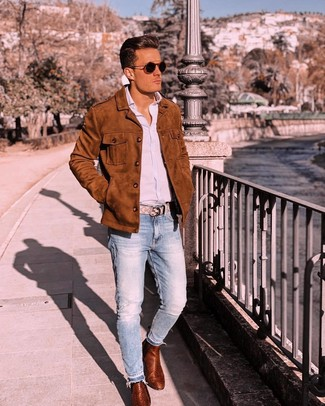 How to wear: tobacco suede shirt jacket, light blue vertical striped long sleeve shirt, light blue jeans, tobacco leather chelsea boots