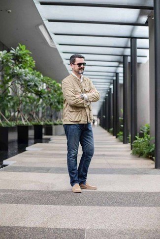 How to Wear a Beige Shirt Jacket For Men: This combo of a beige shirt jacket and navy jeans is put together and yet it's laid-back and apt for anything. Beige suede loafers will bring an element of sophistication to an otherwise all-too-common outfit.