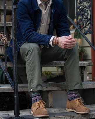 Navy Shirt Jacket Outfits For Men: This pairing of a navy shirt jacket and olive chinos makes for the perfect base for an infinite number of seriously stylish ensembles. Not sure how to finish your look? Round off with a pair of brown suede derby shoes to ramp it up.