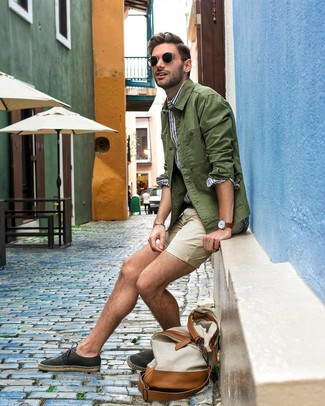 How to wear: olive shirt jacket, white and blue vertical striped long sleeve shirt, beige shorts, black canvas espadrilles