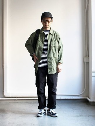 Silver Bracelet Outfits For Men: This off-duty combination of an olive shirt jacket and a silver bracelet takes on different moods depending on how you style it out. And if you want to effortlessly perk up this outfit with one single item, introduce black and white canvas low top sneakers to the equation.