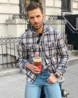 How to wear: multi colored plaid shirt jacket, grey long sleeve t-shirt, light blue jeans, black sunglasses