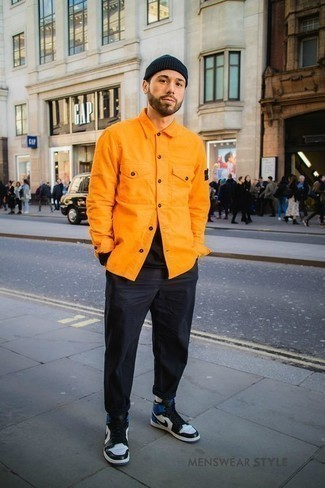 How to Wear Black Jeans For Men: For a casually cool look, wear an orange denim shirt jacket with black jeans — these pieces fit pretty good together. Complement your look with a pair of white and navy leather high top sneakers to instantly amp up the wow factor of your outfit.