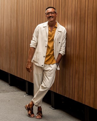 How to Wear Sandals For Men: Combining a white shirt jacket and white chinos is a surefire way to breathe refinement into your styling lineup. Balance your ensemble with a more casual kind of footwear, such as these sandals.
