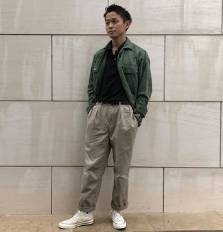 Black Polo with Chinos Outfits: We're loving how a black polo partners with chinos. Here's how to bring a more casual spin to this outfit: white canvas high top sneakers.