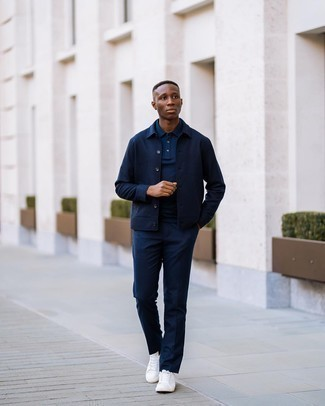 Navy Shirt Jacket Outfits For Men: A navy shirt jacket and navy chinos are among the foundations of any versatile wardrobe. Showcase your fun side by rounding off with white canvas low top sneakers.