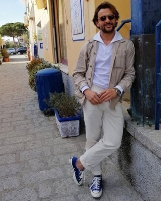 Men's Outfits 2020: This pairing of a beige shirt jacket and beige chinos is a mix between elegant and casual. If you wish to immediately tone down your getup with a pair of shoes, add blue canvas low top sneakers.