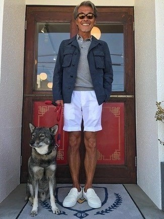 White Canvas Slip-on Sneakers Outfits For Men: For an outfit that provides function and dapperness, wear a navy shirt jacket with white shorts. White canvas slip-on sneakers will pull the whole thing together.