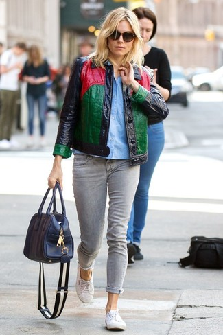 Sienna Miller wearing Multi colored Leather Shirt Jacket, Light Blue Short Sleeve Button Down Shirt, Grey Jeans, White Canvas Low Top Sneakers