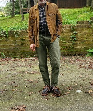 Dark Brown Leather Boat Shoes Outfits: For an outfit that's casually neat and camera-worthy, dress in a tan shirt jacket and olive chinos. Feeling creative today? Play down this ensemble by slipping into dark brown leather boat shoes.