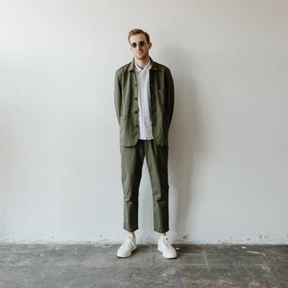 Olive Chinos Outfits: When it comes to rugged sophistication, this pairing of an olive shirt jacket and olive chinos doesn't disappoint. If you need to easily play down this outfit with shoes, introduce a pair of white canvas low top sneakers to the equation.