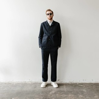 Charcoal Sunglasses Outfits For Men: Choose a navy shirt jacket and charcoal sunglasses to achieve an interesting and modern casual outfit. If you feel like dressing up a bit, add white canvas low top sneakers to this look.