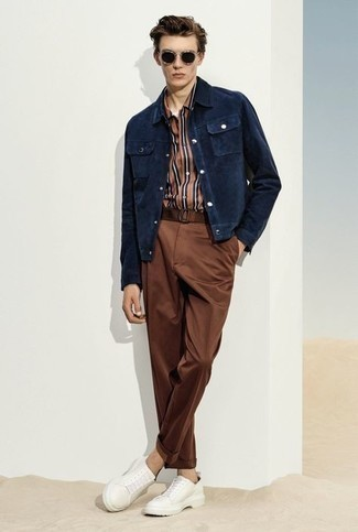 Brown Chinos Spring Outfits: For an outfit that's worthy of a modern fashionable gent and casually sleek, dress in a navy corduroy shirt jacket and brown chinos. Complete this getup with a pair of white canvas low top sneakers to add a hint of stylish casualness to your outfit. So if you're on a mission for a knockout look that transitions easily into spring, this one fits the bill.