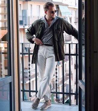 Shirt Jacket Outfits For Men: A shirt jacket and white chinos married together are a perfect match. A pair of tan canvas low top sneakers effortlessly ups the fashion factor of your outfit.