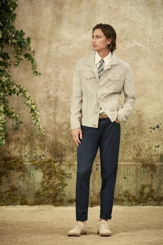 Grey Shirt Jacket Outfits For Men: This pairing of a grey shirt jacket and navy jeans is hard proof that a safe casual outfit doesn't have to be boring. When it comes to footwear, complete this outfit with beige suede desert boots.