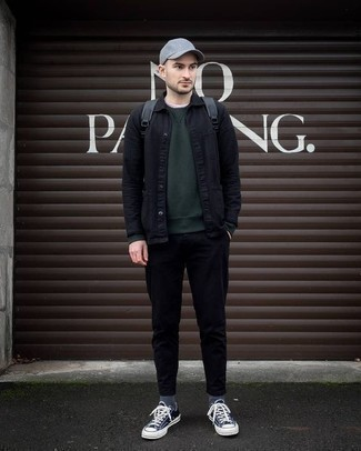 Dark Green Sweatshirt Outfits For Men: Fashionable and functional, this laid-back combination of a dark green sweatshirt and black chinos will provide you with variety. Let your sartorial skills truly shine by finishing your outfit with navy and white canvas low top sneakers.