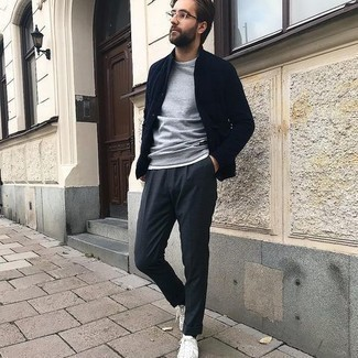 Sweatshirt Outfits For Men: Rock a sweatshirt with charcoal dress pants if you're aiming for a proper, stylish getup. White canvas low top sneakers are the simplest way to inject an element of stylish nonchalance into this getup.