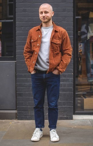 How to Wear a Grey Sweatshirt In Your 30s In Spring For Men: A grey sweatshirt and navy jeans worn together are a nice match. White leather low top sneakers complete this look quite nicely. With springtime coming, it's time to make space for simple and on-trend combos, just like this.