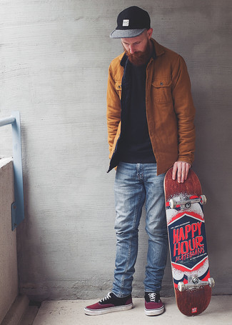 Light Blue Jeans Outfits For Men: When the setting permits casual dressing, try pairing a tobacco shirt jacket with light blue jeans. And it's a wonder how purple canvas low top sneakers can update a look.